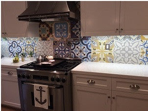 Bright colors and bold patterns found in cement tile are used for this patchwork design.