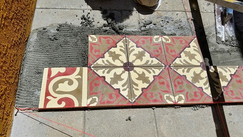 When installing a cement tile pattern or rug, start with the main field pattern in the center, then the border
