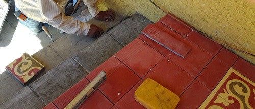 Install cement tiles with a narrow grout joint on a clean, level surface