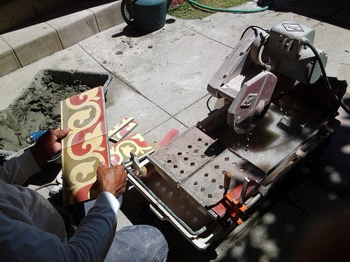 Cement tiles tiles can be cut using a wet saw with a diamond blade