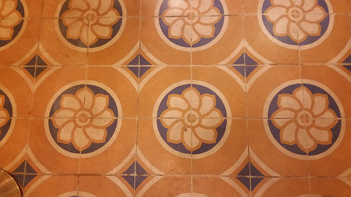 A close-up detailing the cement tile pattern found in the Barber Shop