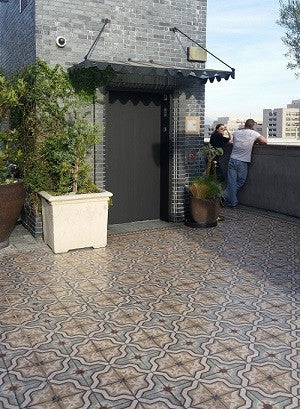 The outside terrace at Perch in Los Angeles, CA uses cement tiles