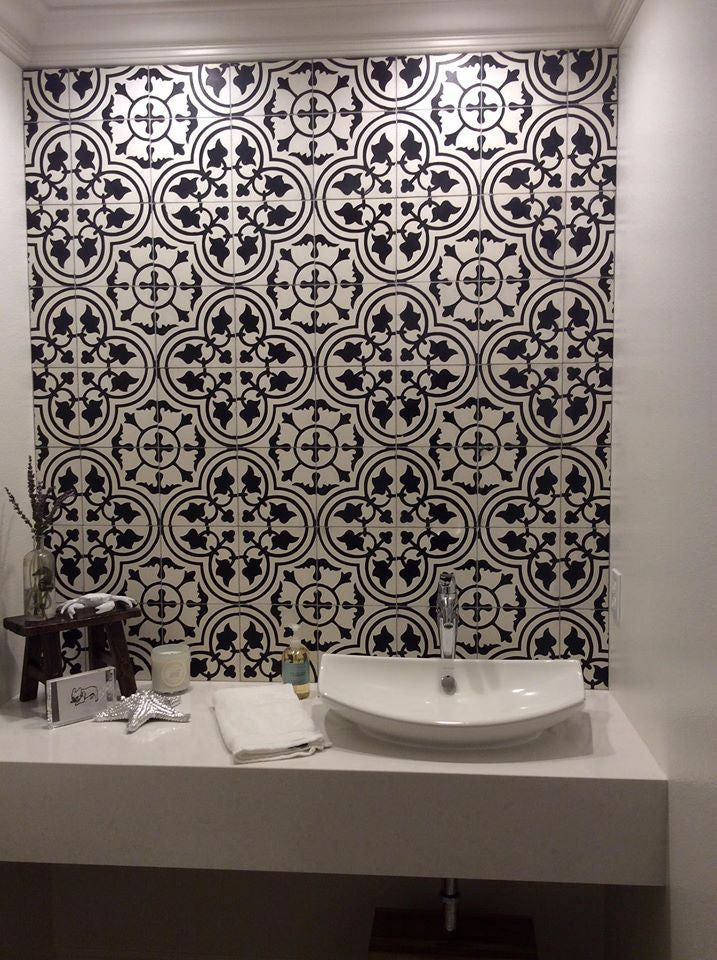 This cement tile in a classic black and white pattern makes a stunning powder room backsplash