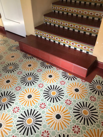 Colorful cement floor tiles are made by hand