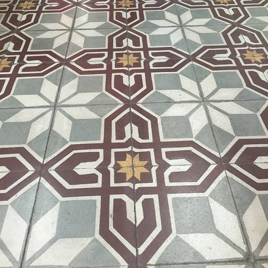 Cuban cement tile patterns use floral or geometric motifs, like the one shown here