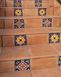 Decorative Talavera tiles on the risers pair well with Saltillo tiles