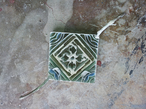 Pigmented Cement is Poured into Different Sections of a Mold to Create the Tile's Pattern