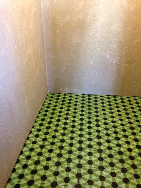 A bold geometric encaustic cement tile pattern for the restaurant's lavatory.