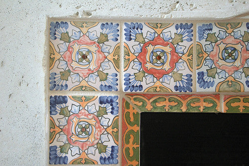 Hand painted Spanish tiles create a rustic look