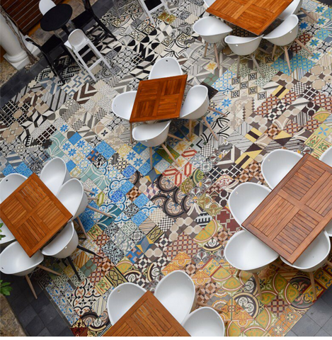 Colorful and fun cement tiles are randomly placed to create a fun and interesting dining space for this restaurant