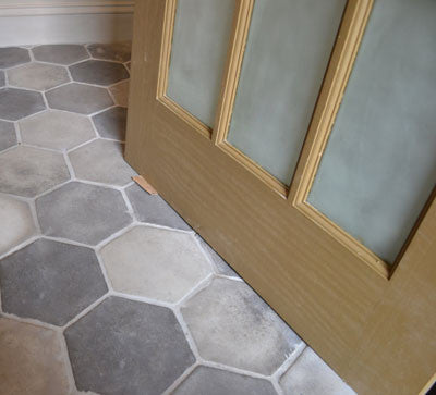 Hexagon tiles in a gray color palette of Antique Gray Smoke and Sidewalk Gray & Hexagon Cement Tile Buying Guide \u2013 Avente Tile
