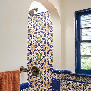 Hand-painted Spanish wall tile are used for the show and bathroom wall