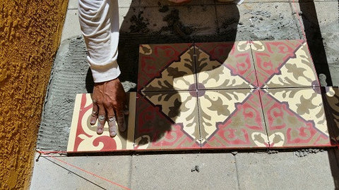 Level cement tile using your hand