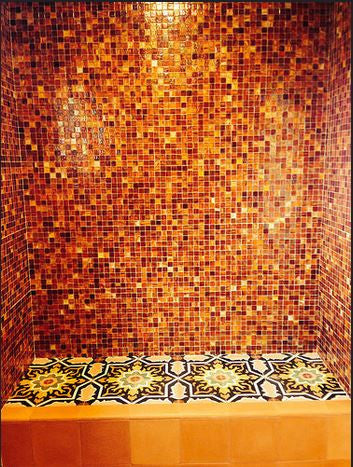 Cement tiles on the floor combine effortlessly with mosaic tiles