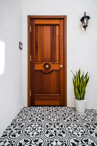Mission Roseton Cement Floor Tile in Black and White Provides a Charming Welcome for This Entry