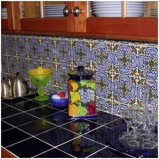 Patterned tile with a border are the right scale for this kitchen.