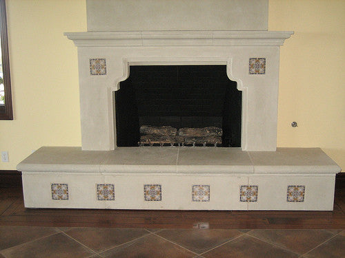 A fireplace using hand painted Spanish Tile