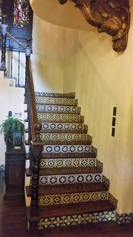 A grand staircase with Spanish tile and tile floor molding in La Casa Nueva