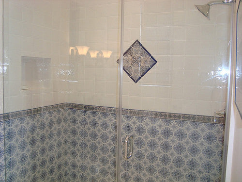 Spanish Tile are used in this as bathroom wainscot in the shower