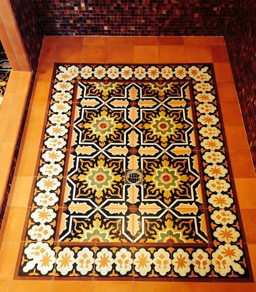 Warm colors for this cement tile rug make for a stunning walk in shower for the master bath