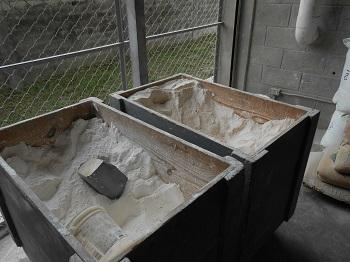 Calcium carbonate in these bins will be mixed to form the color layer