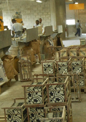 Cement tiles dry on metal racks at factory