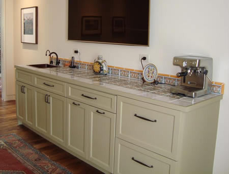 Crowell Residence Wet Bar uses decorative Spanish tile with hand-painted plain tile and molding