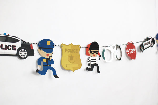 paper garland with a police car, robber, policeman, police badge,stop sign and hand cuff