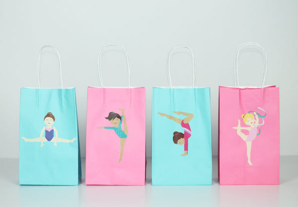pink and teal paper gift bags with gymnastics girls stickers