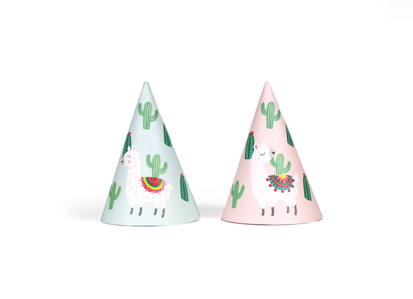 llama and cactus party hats in light teal and light pink