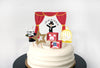 magician party cupcake toppers of a kid magician, bunny, dove in a cage and gold glitter star on a white cake