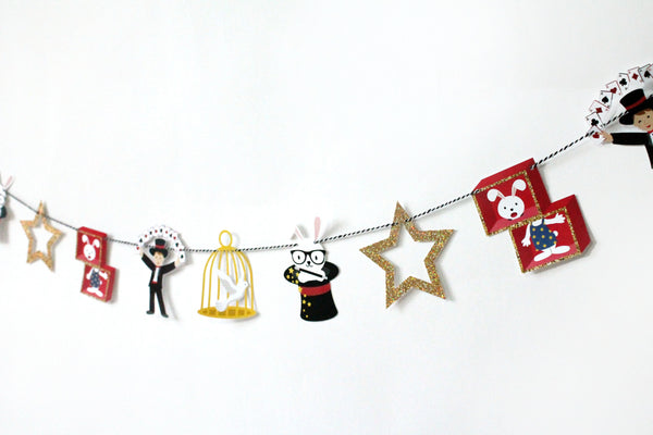 magician party garland featuring a kid magician, dove in cage, bunny in a hat and gold glitter star