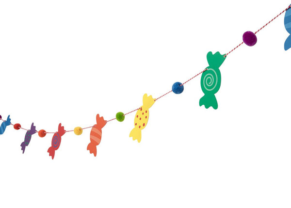 rainbow colored candy and pom pom garland