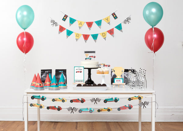 vintage race car party set including happy birthday banner, garland, cupcake toppers, party hats, and teal and red balloons