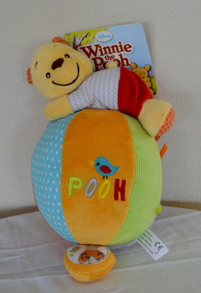 Pooh on top of a Ball