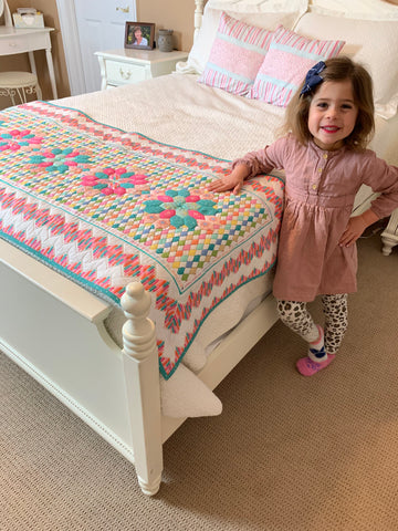 Quilted coverlet made with Mister Domestic's Playroom Party Fabrics by Art Gallery Fabrics