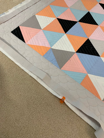Estimate where the binding seam are so they don't fall at the corners.