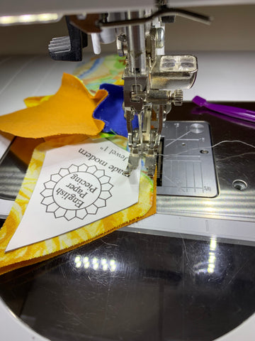 Stitching Jewels to Daisy Chain Quilt