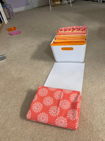 Folding fabric to fit in large Ikea container
