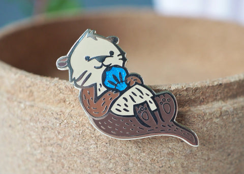 LanaBetty Blue Sparkle Sea Otter Enamel Pin - LanaBetty - available from Majesty and Friends