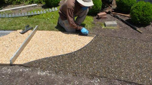 image of person installating the gravel locking material