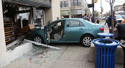 car crashed into front of store