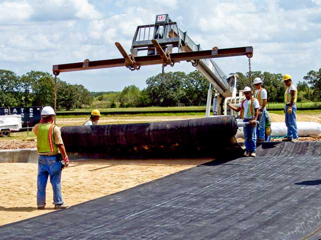 Building a roadway with woven geotextile fabric