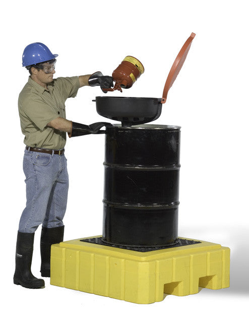 man pouring liquid into black drum over yellow spill pallet