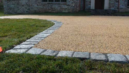 Amber color permeable gravel driveway