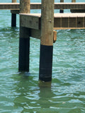 Image of a dock piling wrapped in a protective plastic