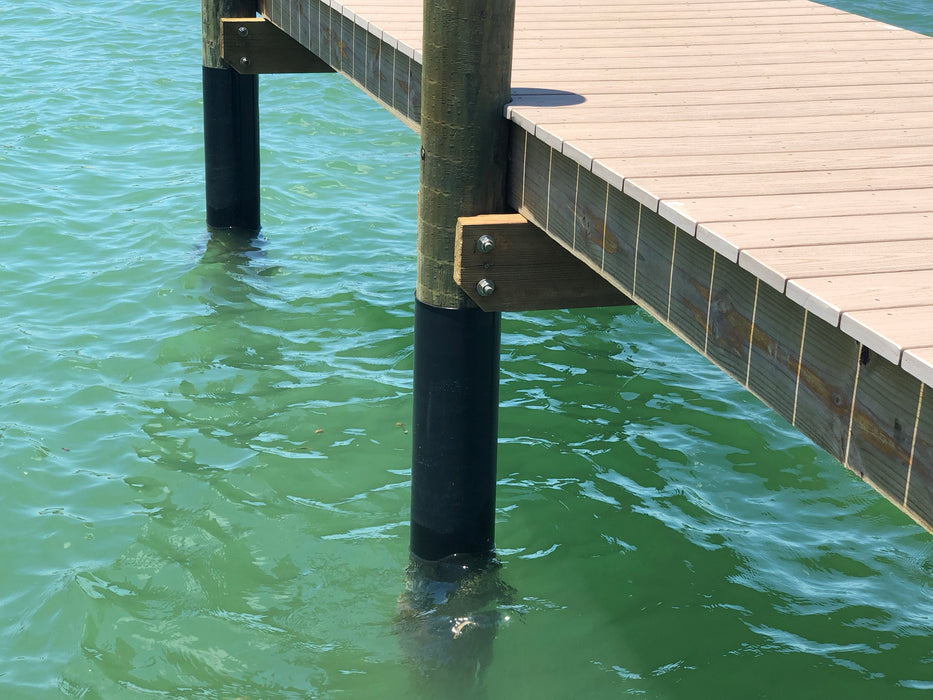 Dock post wrapped in plastic sheeting