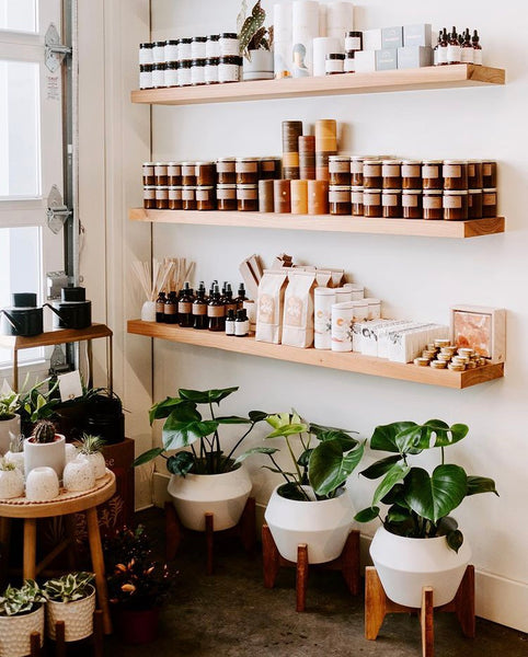 Candles, plants, and body care goods grace the shelves of That Feeling Co. in Anchorage, AK