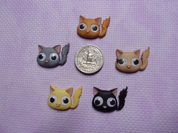 Google-eyed Cats needle minders