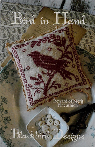 Blackbird Bird in Hand Reward of Merit pincushion cross stitch pattern